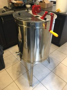 Photo of a 4 frame manual honey extractor